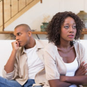marriage will end in divorce: unhappy couple sitting on the couch