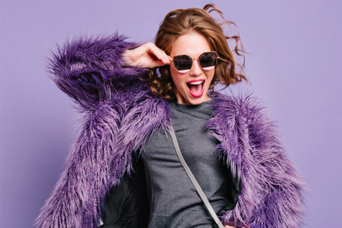 life after divorce: happy woman in purple fur coat with sunglasses