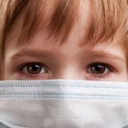 covid-19 and child custody access: young boy in surgical mask