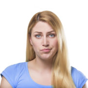 single parenting: blonde woman in blue top pouting